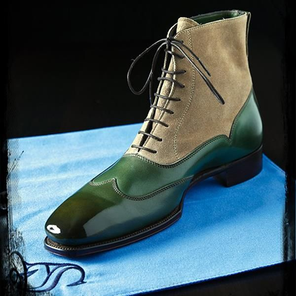 Yes...green leather with taupe suede upper, two tone balmoral boots...does anyone know the designer? Possibly Marc Guyot...not sure.