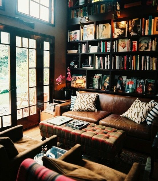 I love home libraries. Squeeze a library into even the smallest spaces--to make homes seem cozier.