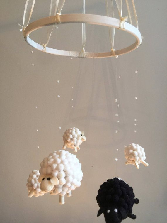 Delicate nursery mobile of woolly sheep. Hanging from invisible thread with glistening pearls, the perfect addition to your little darlings