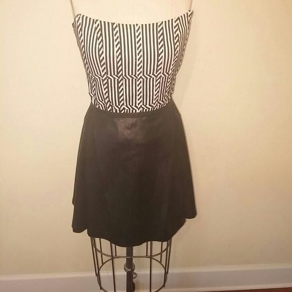 Polo Ralph Lauren Skirt Black gun metal skirt with pleats in the front and back. Picture does not do this skirt justice! It is super cute! Can be dressed up or down. Polo by Ralph Lauren Skirts