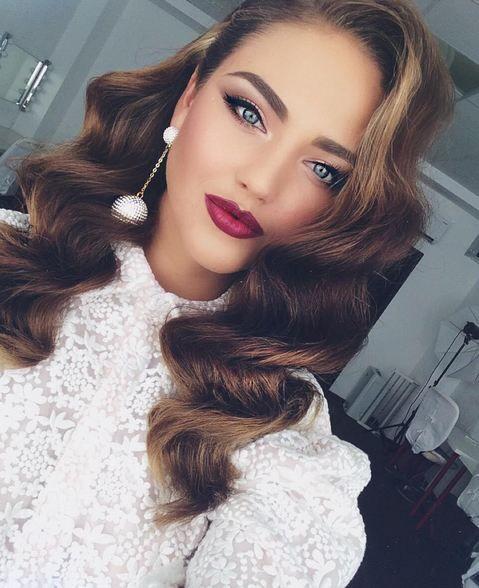 long ash blonde wavy curls hair, hairstyle, hairdo, soft smokey eye, winged eyeliner, make up, burgundy lips