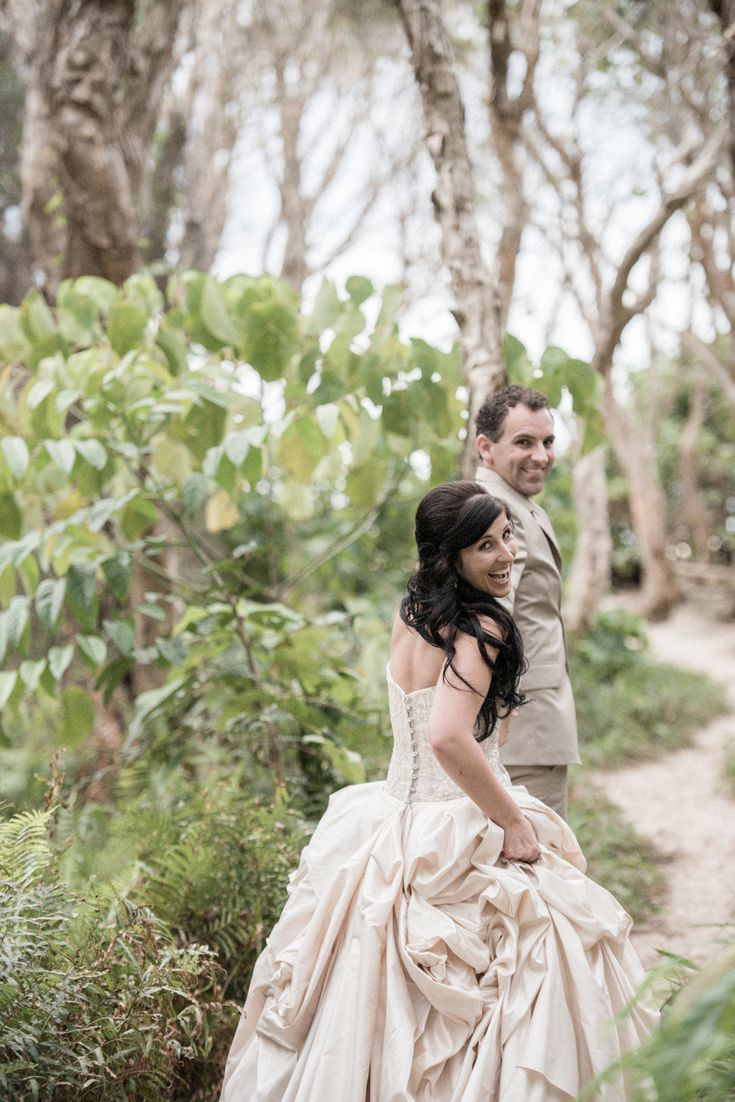 Gorgeous bride getting pulled along a forest track to the beach.   North Stradbroke Island stradbrokeislandphotography.com