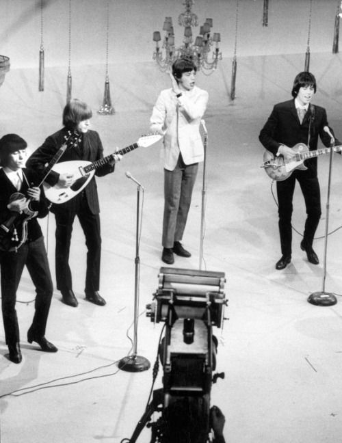 """The Rolling Stones performing at the """"Ed Sullivan Show"""", 1965. Photo by John Loengard."""