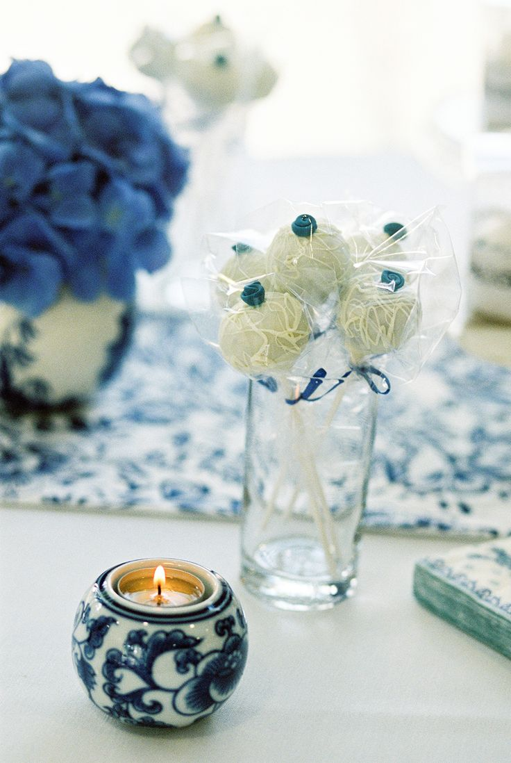 Blue dessert table with white chocolate pops - Image by Samantha Ward Photography - A chinese influenced wedding in York with a blue and white colour scheme , hydrangea and garden games