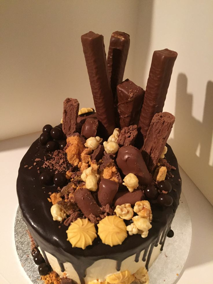 Chocolate Mud Cake with Caramel Buttercream. Dark chocolate drizzle with chocolate and caramel goodies on top cake