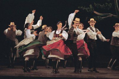 "Hungarian State Folk Ensemble Eighty Dancers and Folk Gypsy Orchestra ""Regarded as one of the greatest folkloric dance ensembles in the world, the company performs authentic folk-music and preserves the folk dances and traditional costumes of Hungary and Hungarian-inhabited areas."""