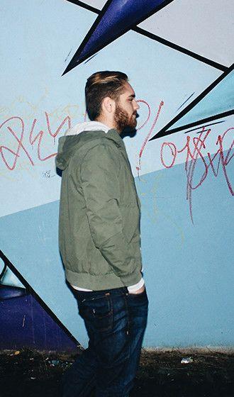 Reykjavik street style: keep it simple with dark denim, light hoodie and a green padded jacket