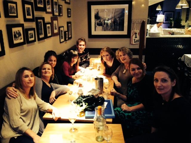 The OXCOM team Christmas meal, all stuffed and very merry!