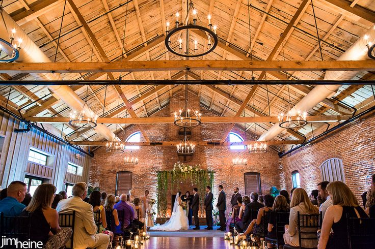 cork factory hotel - lancaster   Picture of the altar - as discussed with greens draping on the front and sides with the candle lights dangling in the back also mixed in with the greens
