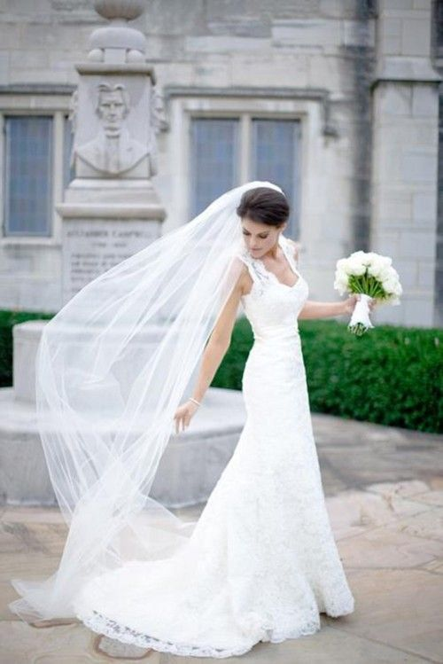 Beautiful Lace Wedding Gown With Long Veil And White Bouquet