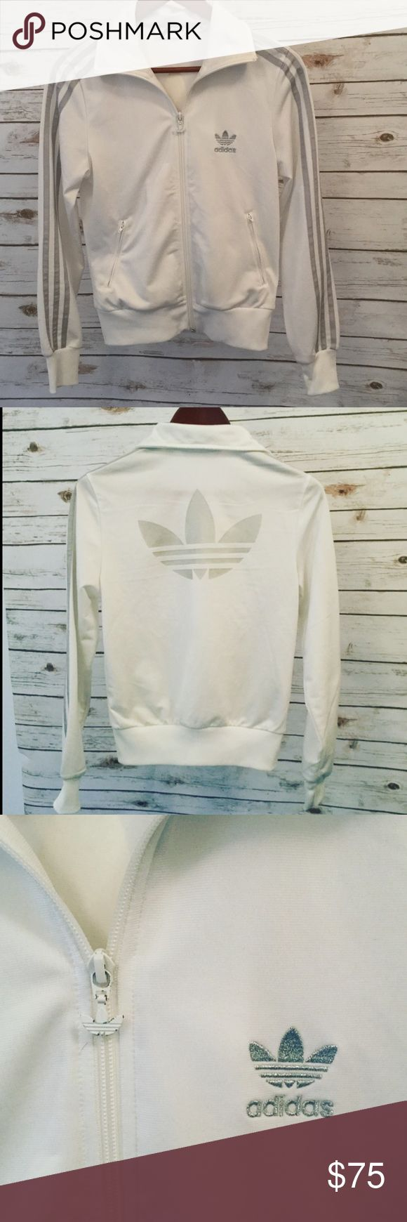 Adidas Original White/Silver Zip up NEW!! Brand New! FINAL PRICESuper Cute white with silver stripes down sleeves and silver adidas original emblem on the back and front.  Will look SO Adorable with your favorite distressed jeans or workout pants! Brought it with me on vacation but was too warm for it so I didn't wear it, washed it when i unpacked it so theres no tags. Adidas Jackets & Coats