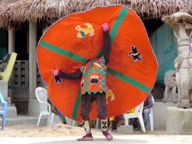 A voodoo dancer twirls his cape at Ganvie village on Lake Nokoue near Cotonou, Benin.