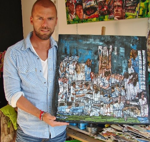 """Gregory Berben and his artwork """"Droit au But"""" that will be auctioned to collect funds for the French charity CéKeDuBonheur, lead by Helene Sy, wife of French actor Omar Sy"""