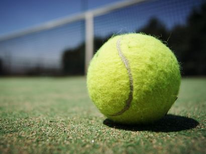 """At the beginning of a tennis match, when both sides have no score, the game is love-love because, in tennis, love means having a score of zero. The Oxford English Dictionary suggests that the term might be rooted in the colloquial phrase """"for love,"""" meaning """"without stakes being wagered."""" This theory reflects the sport's long history of etiquette and sportsmanship. Others theorize that love arose from the French word for """"egg,"""" l'oeuf, because a zero on a scoreboard resembles an egg."""