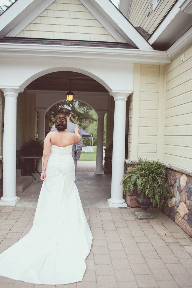 First look with bride and groom, tapping on shoulder - photo by New Vintage Media