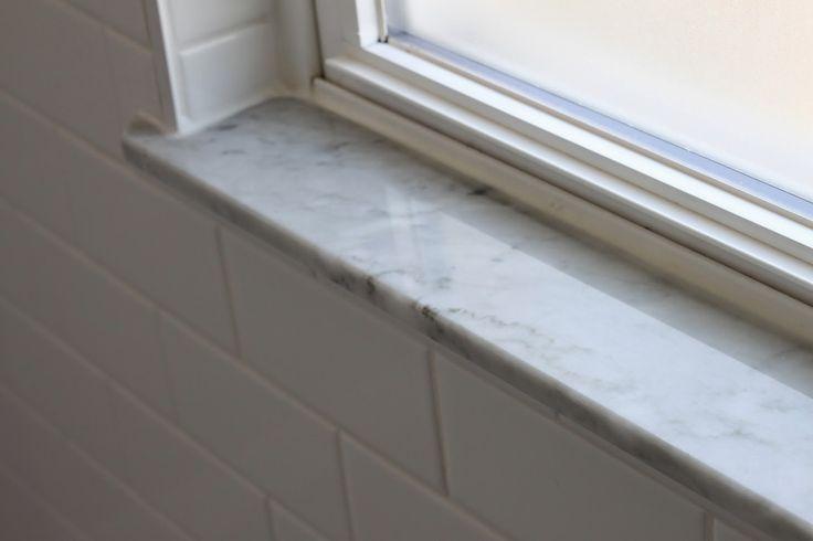 Modern Jane Bathroom Renovation. Marble sills.