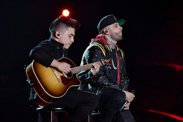 Nicky Jam Photos - Nicky Jam (R) performs onstage during The 18th Annual Latin Grammy Awards at MGM Grand Garden Arena on November 16, 2017 in Las Vegas, Nevada. - The 18th Annual Latin Grammy Awards - Roaming Show