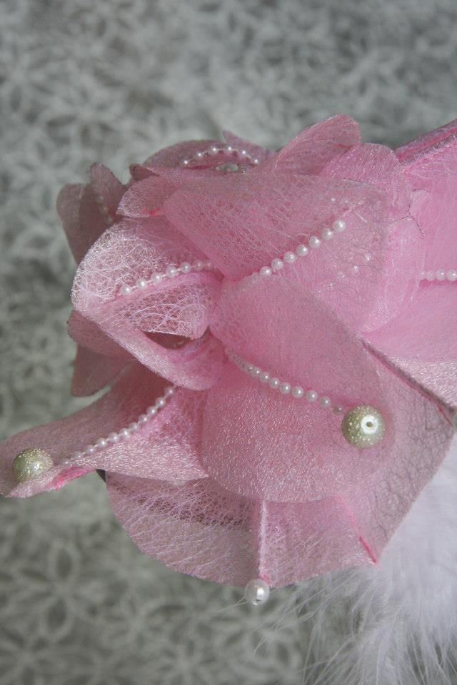 Pink textured organza and pearls, and intricate stitching
