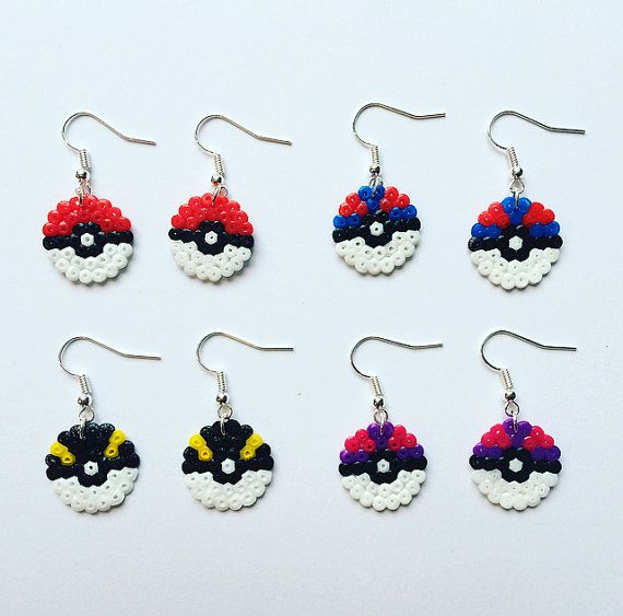 A pair of super-cute Pokeball earrings, perfect for any Pokemon fangirl (or fanboy!)  Handmade using mini Hama / Perler beads with silver-plated earrings. Ive used a circular board for a more realistic effect.  Available in the following designs:  - Poke Ball (red and white) - Great Ball (blue and red) - Ultra Ball (black and yellow) - Master Ball (purple and pink)  Love them all? Just select Full Set of Four from the drop-down menu to receive one pair of each.  Both sides have been ironed…