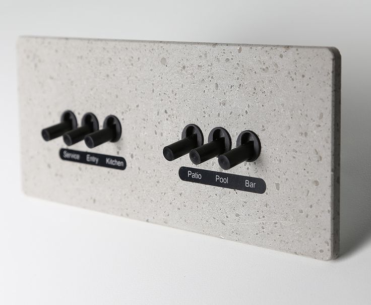 LUMEN8 Light Switches   FINISH: Concrete LEVER: Pod 6 lever with labels