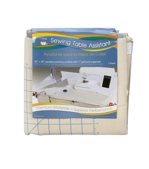 """""""Dritz Sewing Table Assistant"""".     20'' x 38'' padded pressing surface with 1'' grid and organizer    Sewing table assistant's heavy-duty ultra plush pad permits soft, smooth & quieter ironing. It's heavy duty cotton helps fabric from excessive slipping. The assistant provides a built in pin cusion, detachable pockets(3), scissor holders(2), waste bag and reversible heat reflective ironing blanket."""