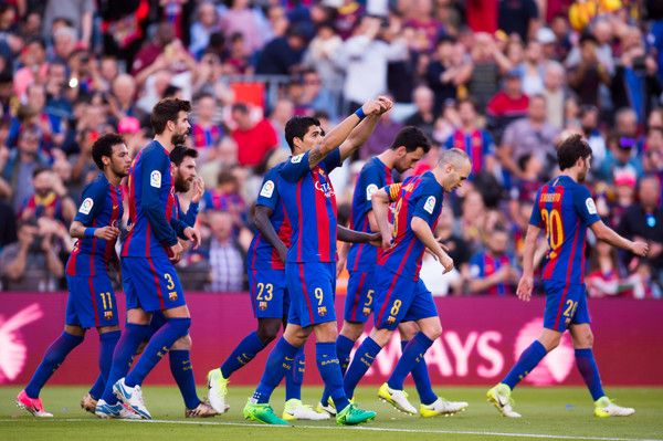Luis Suarez (C) of FC Barcelona celebrates after scoring his team's third goal during the La Liga match between FC Barcelona and Villarreal CF at Camp Nou stadium on May 6, 2017 in Barcelona, Catalonia.