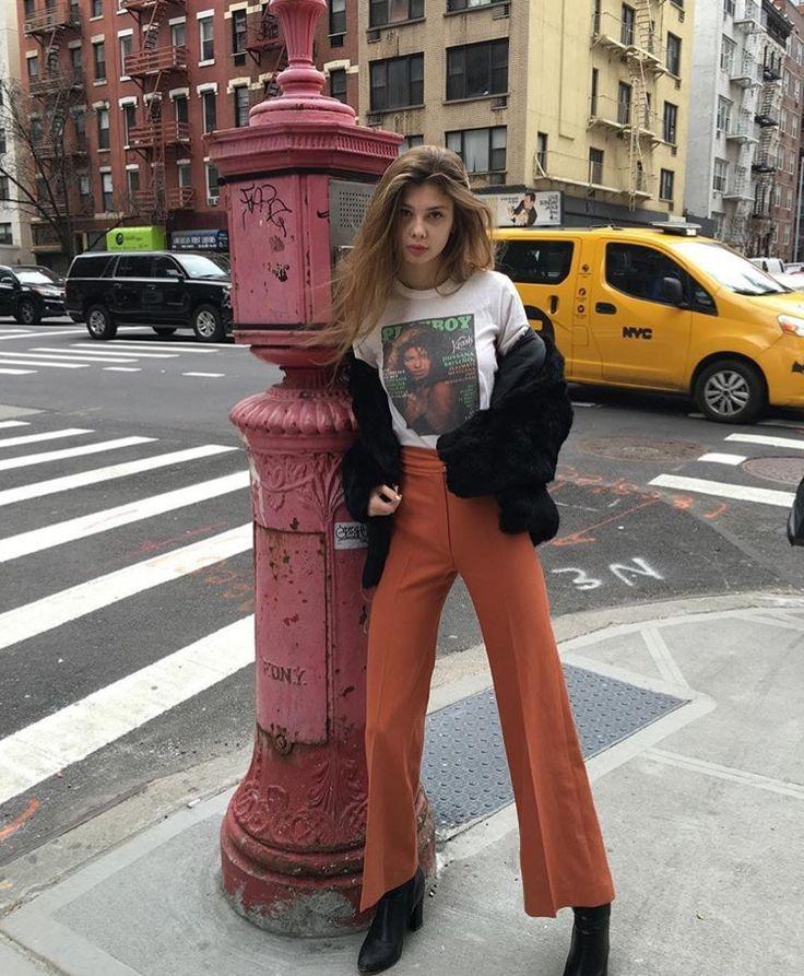 Punk-inspired street style Band t-shirt, black faux fur jacket, and rust high-rise flair pants. -MB - ̗̀ @artsyautumn ̖́-