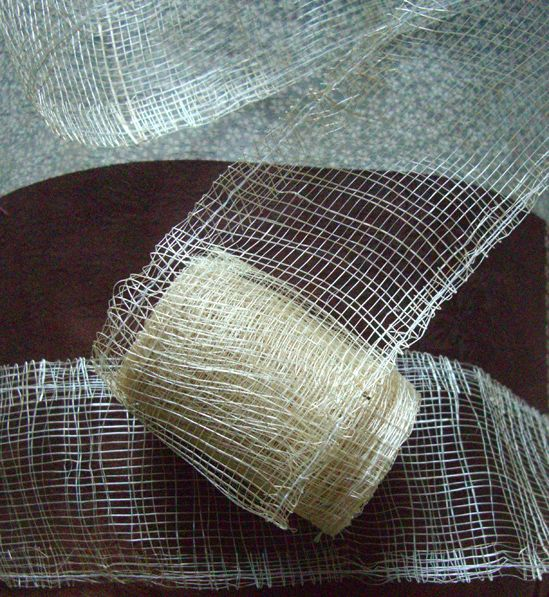 3.59 SALE PRICE! Incorporate natural texture into your wedding or home décor with this netted trimming. The Sinamay Ribbon is composed of slender, natural fi...