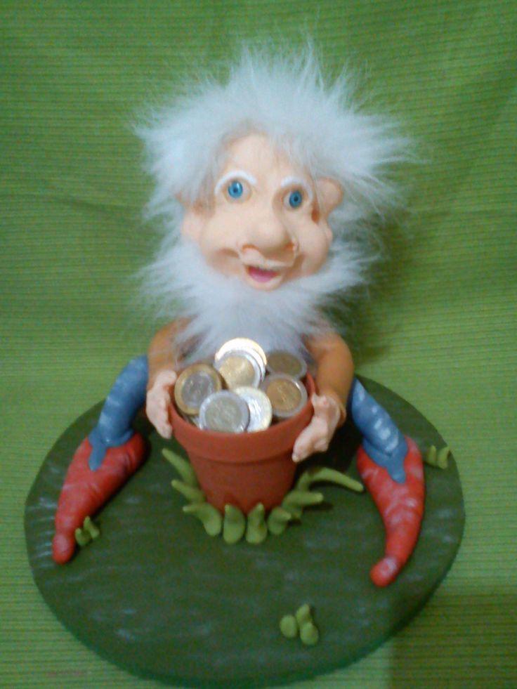duende co vasija de monedas