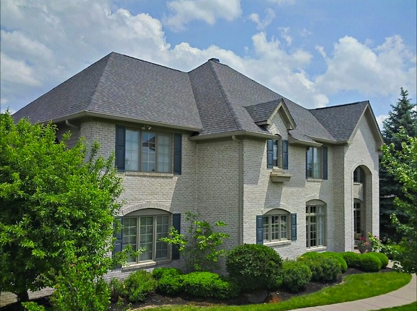 Outstanding re-roofing project by Elk Roofing LLC in Indianapolis. The home features Landmark roofing shingles in the color Driftwood.