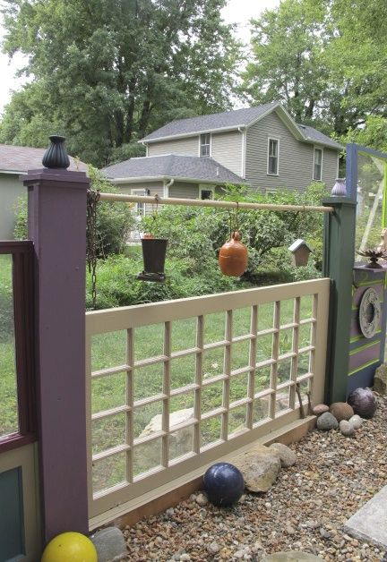 Such a creative solution for a fence line....I can picture using the old doors and windows around a veggie garden...would be so cute!  I love the way she painted each door and window different colors!  Hometalk :: The Fence (recycling Old Doors and Windows)