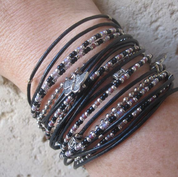 Boho Chic Black Leather Triple Wrap Bracelet with Silver, black and purple Miyuki beads. $38.00, via Etsy.