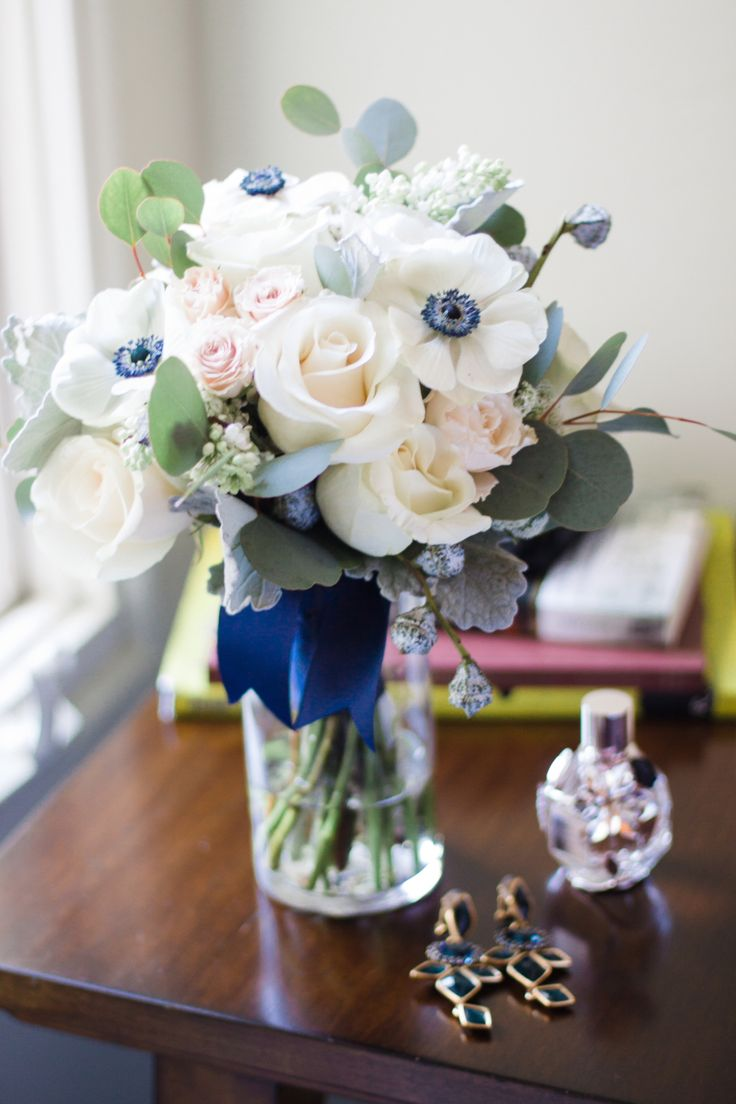 Blush, white, and navy blue wedding flowers on Borrowed & Blue.  Flowers: Emlily Floral Designs. Photo Credit: For the Love Photography. Panda anemone Bridal bouquet with blush and navy blue accents!