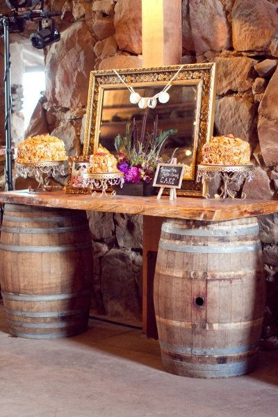 I'll be yours sweet iced tea blog - gorgeous rustic buffet using wine barrels and a wooden top.