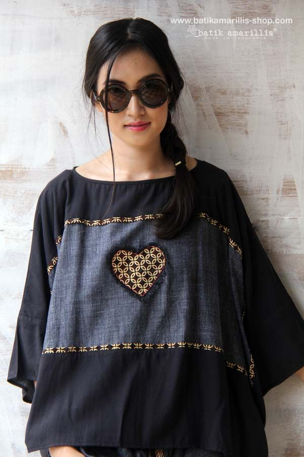 batik amarillis's boxy blouse Cut in a contemporary-cool, boxy silhouette, this provocative oversized flowy two tones cotton-linen blend and rayon blouse iis accented with solid panels of batik frame plus heart /Flower batik aplique which uniquely frayed at the edge! Size: All/ S-L (bust max: 108cm, lenght: 58cm)