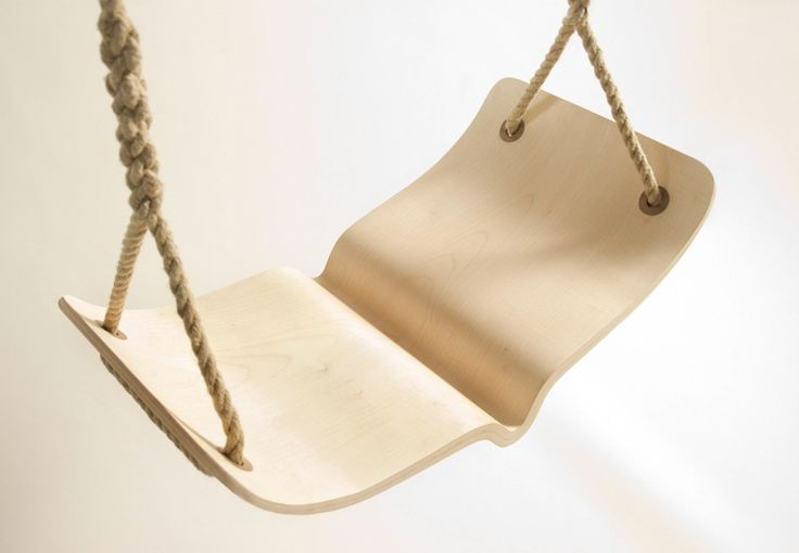 "The ""Fugle"" swing is inspired by Scandinavian bentwood design. The seat is made out of maple and walnut and the rope is natural hemp. Photo courtesy of Christina Fesmire."
