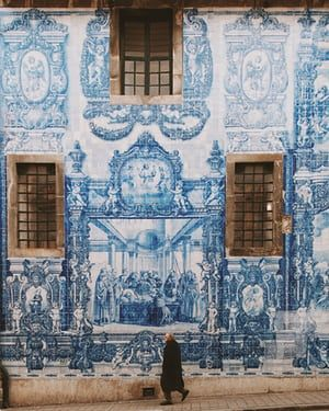 Kind of blue: Porto's azulejo facades – in pictures - via The Guardian 14-12-2017 | Miles of tiles. The Capela das Almas is a magnificent example of the azulejo-clad facades that dominate Porto. The golden age of the painted ceramic tile was the late 17th to early 18th century but these scenes were painted by Eduardo Leite in the early 20th century.