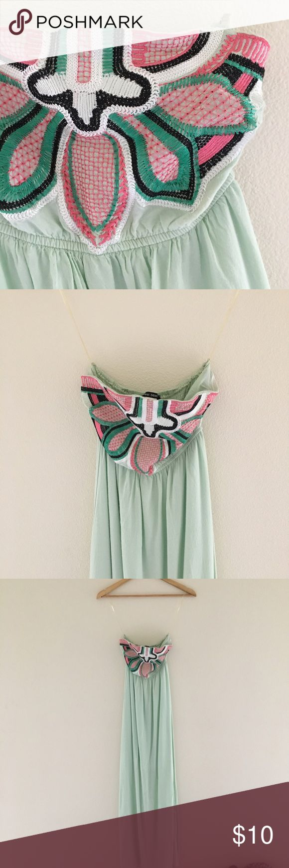 """Mint Maxi Tube Top Dress 🍭 Cute mint strapless tube top dress. Pretty pink/green/black Aztec detailing at the chest. Works best for a larger chest. Lined to a mini dress (see photo 6). Worn/washed once. ✨Some pilling at hips + a few loose threads in the embroidery. Priced to reflect imperfections.  🍏Material:  100% Rayon 🍏Measurements:  Chest - 12"""" when not stretched Length - 27"""" lining 49"""" shell 🍭🍬Feel free to make an offer. No trades please. From a smoke free home.🍬🍭 West 36th…"""