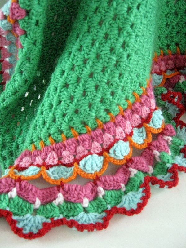 Inspiration:  Colorful crochet edging in bright, happy colors and different stitches.