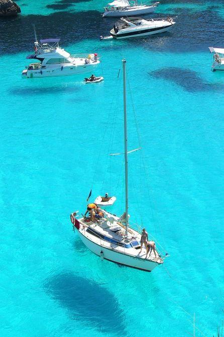 Barcos suspendidos en Macarella, Menorca  Spain