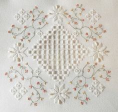 """© Polstitches Designs """"A hardanger designs with full teaching instructions stitched on the Antique White Fabric with a splash of beads, pearls and Gast Hand Dyed Threads for an elegant effect. The design can be used as a cushion, table centre and also makes a wonderful ring pillow Stitched Area 82w X 82h Stitches Design Area 5.86 x 5.86 Inches Designed by Polstitches Designs Kit does contains everything to complete the design. Chart only £8.99, Kit £28.00"""""""