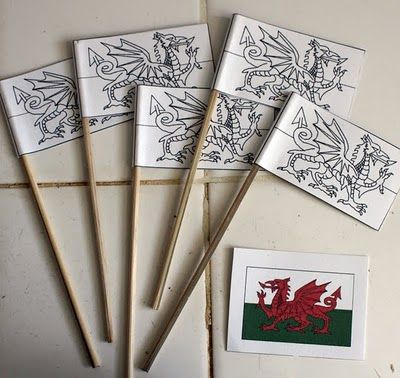 Mini Welsh Flags for St. David's Day 1st March - these have been stuck on back to front!! Do NOT put them on the stick like this! The head must be on the stick so that the tail flaps in the wind!