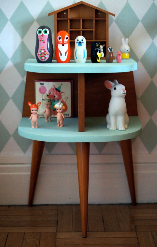 Harlequin wallpaper. Vintage night table. Bunny night light by Rex. Sonny Angels. House-shaped cubby. Miffy.