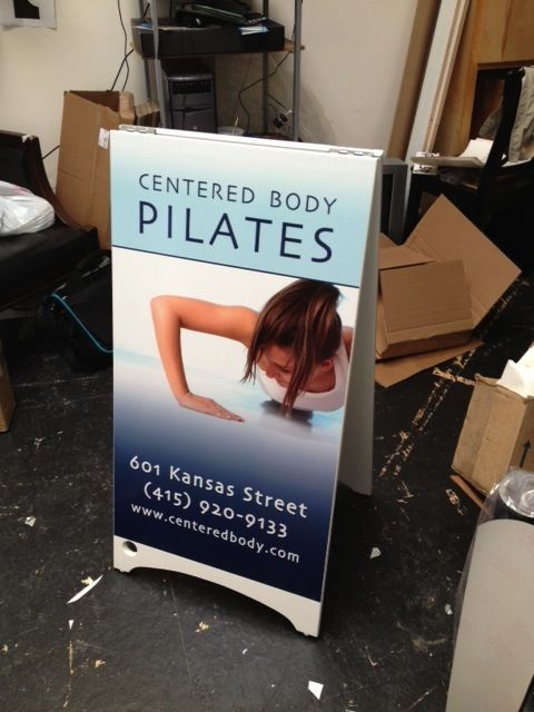 Digital Printed graphics on a-frame sign for a local Pilates studio