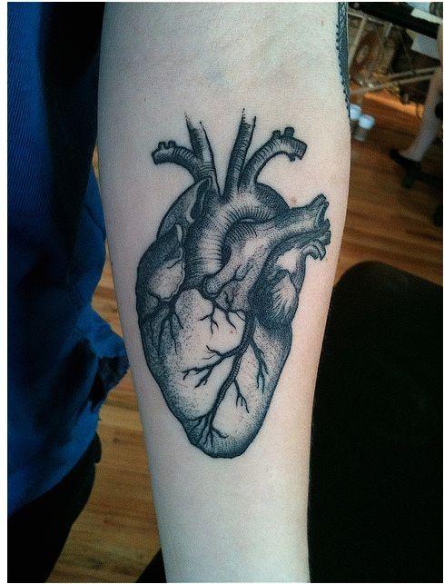 Detailed black grey anatomical heart forearm tattoo