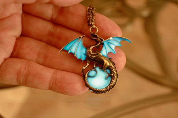 Glow in the dark Dragon Surrounding the Moon by Papillon9 on Etsy, 24.95 This beautiful bronze color Dragon caught my attention immediately, I got the idea to add a moon that glows in the dark, it's wings are glowing in the dark too, the effect is exactly what I wanted, this is a truly unique item!