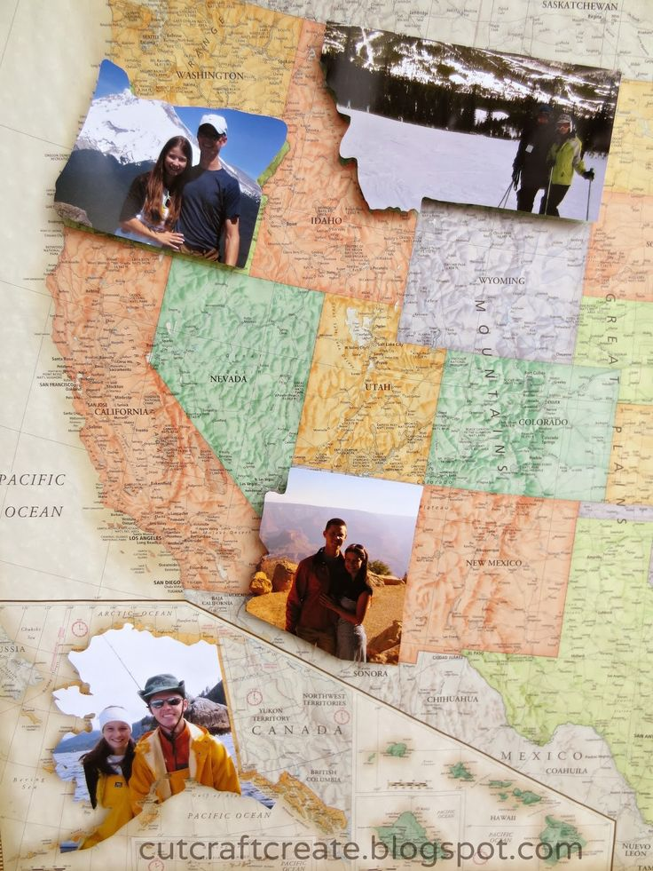 Cut photos in the shape of the state/country where you took them and paste onto map. ♥
