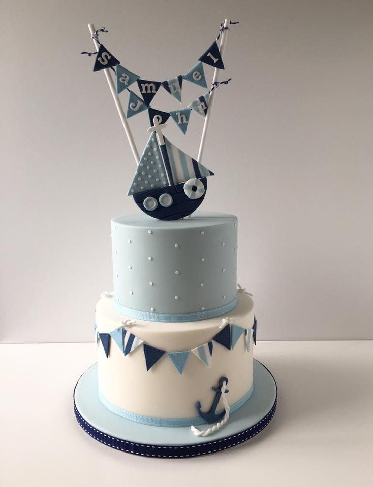 Blue , navy and white polka dot and striped nautical theme christening cake with boat and bunting topper