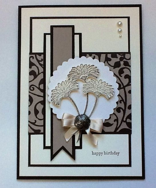 handmade birthday card ... formal look with lots of matted layers arranged in a pattern ... neutral colors ... white, cream, taupe with black matting ... luv this card!!