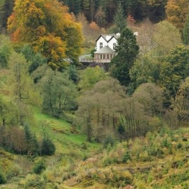 """The Cottage in the Wood: """"The Cottage in the Wood is five miles from Keswick in an area of the Lake District National Park that inspired the famous author and fell walker, A W Wainwright to write 'that the North Western fells are the most delectable of them all'."""